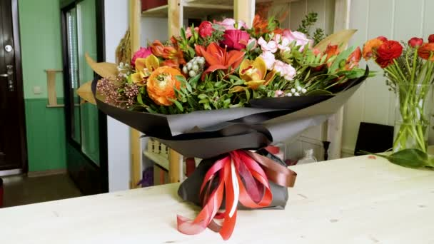 Close-up shot of a beautiful and stylish bouquet of fresh various flowers in floral design studio, flower shop. 4K
