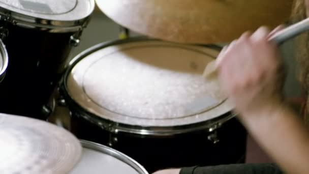 Musical band. Group of musicians playing rock music on stage. Close-up shot of drummer playing the drums by hitting it with sticks. Slow motion. HD