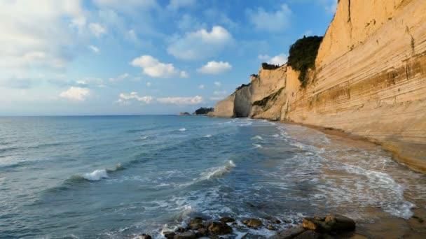 Rocky headland and scenic coastline of Corfu. Landscape of Ionian sea in Greece. Slow motion. HD