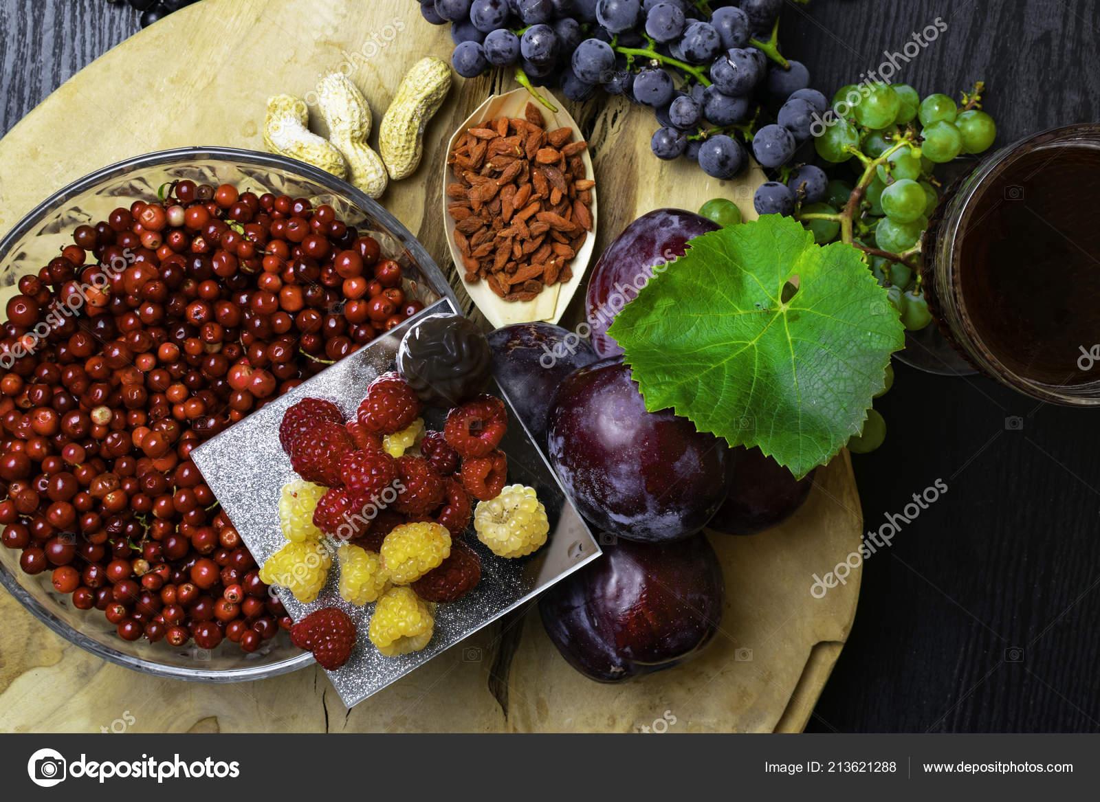 Food Rich Resveratrol Grapes Plums Goji Peanuts Cranberry Raspberrys Dark Stock Photo C Dian4ikn Gmail Com 213621288
