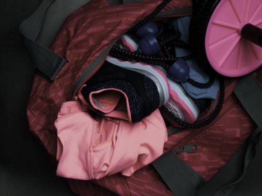 sport bag with fitness set, shoes, expander, roll for press, motivation and health lifestyle concept