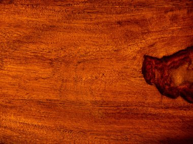 that acacia timber, trim with rosewood red wooden background, vintage surface