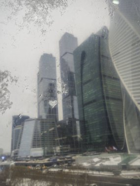 blurry Skyscrapers with glass facades. Abstract modern buildings exterior design, view from window