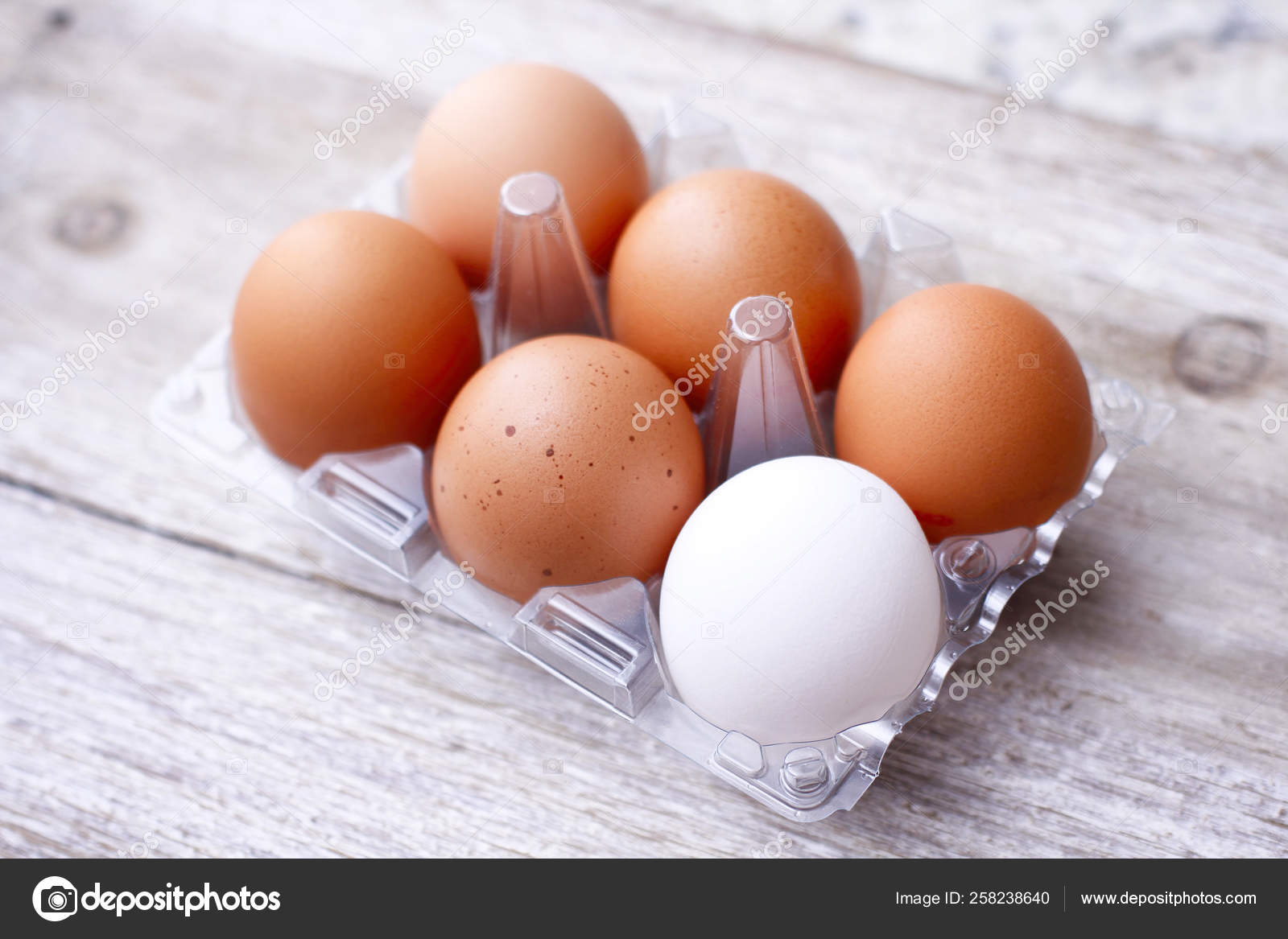 Six Eggs Plastic Packing Wooden Table One Different Color Egg Stock Photo C Exi 258238640
