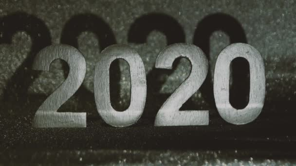 The light moving on 2020 number with silver glitter glamour , new year coming concept , 2020 celebration countdown, eve. Close up.