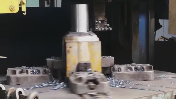 Milling machine cutting the sample part. Turning lathe in action.Facing operation of a metal blank on turning machine with cutting tool. Rolling mill preparation workshop. Machining of machine parts