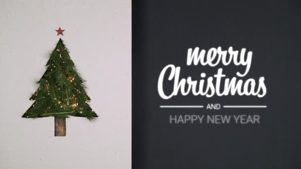 Overhead natural christmas tree pine decoration with blinking lights on cardboard with merry christmas and happy new year.Vertical top view loop.Xmas holiday season social card background.4k video