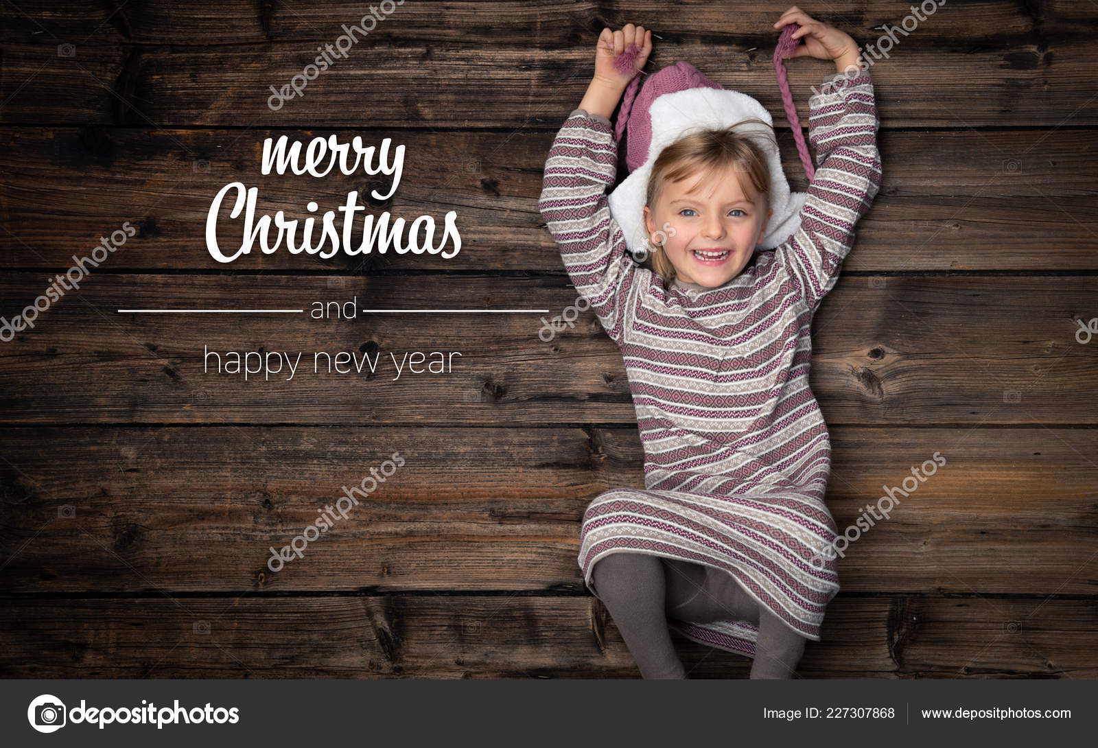 merry christmas and happy new year greetings in vertical top view dark vintage wood beautiful happy child girl in homewearchildhood concept