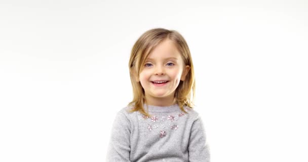 Beautiful happy fun young child blond smarty girl smiling and making faces.Person action.People video portrait isolated on white background.Medium shot.4k video