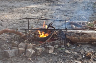 A bonfire in the forest  burns on amangal