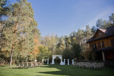 arch for the wedding ceremony in fall in the park