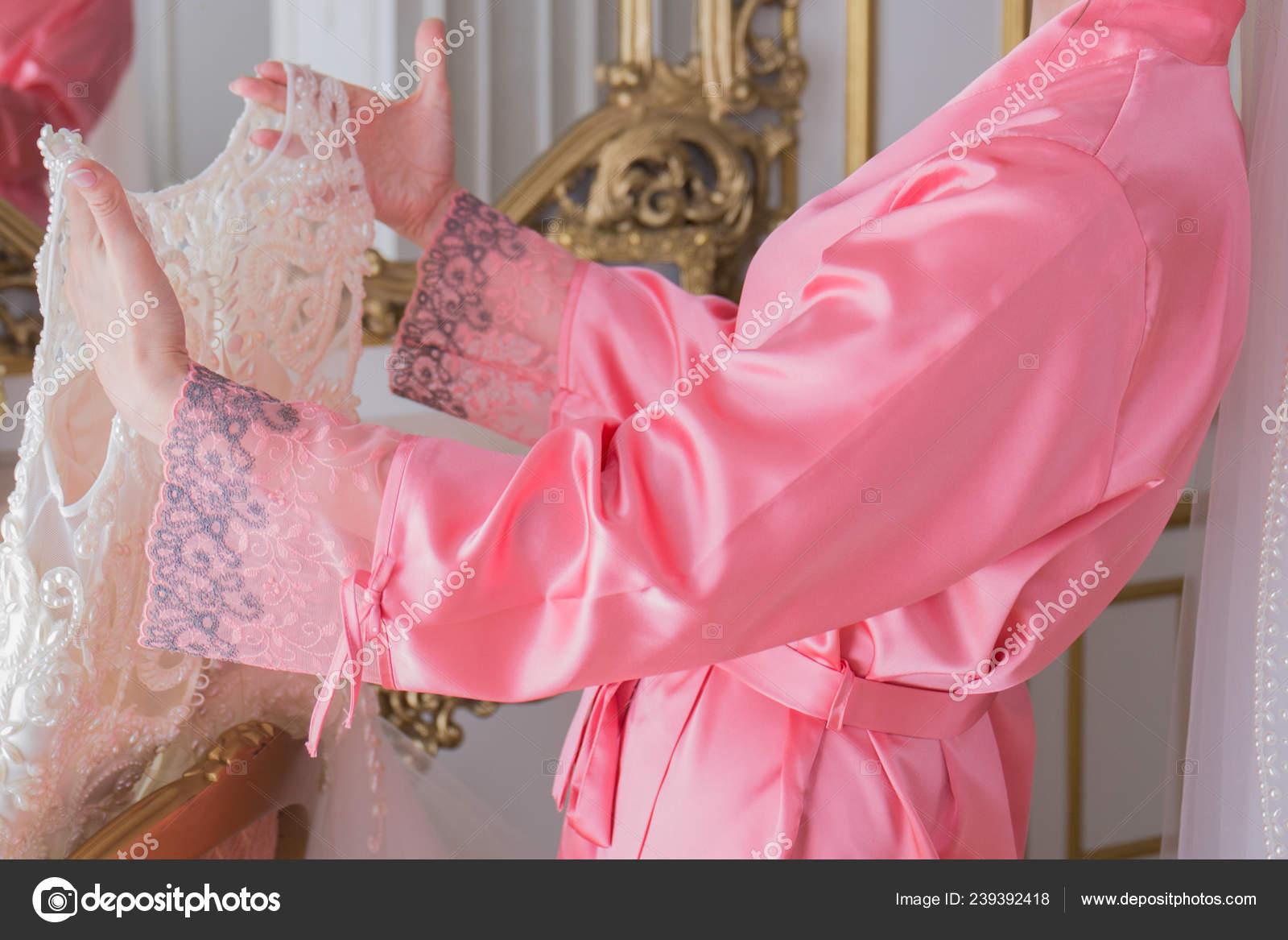 Bride In A Bathrobe Near Her Wedding Dress Stock Photo C Dyachenkoproduction Ukr Net 239392418
