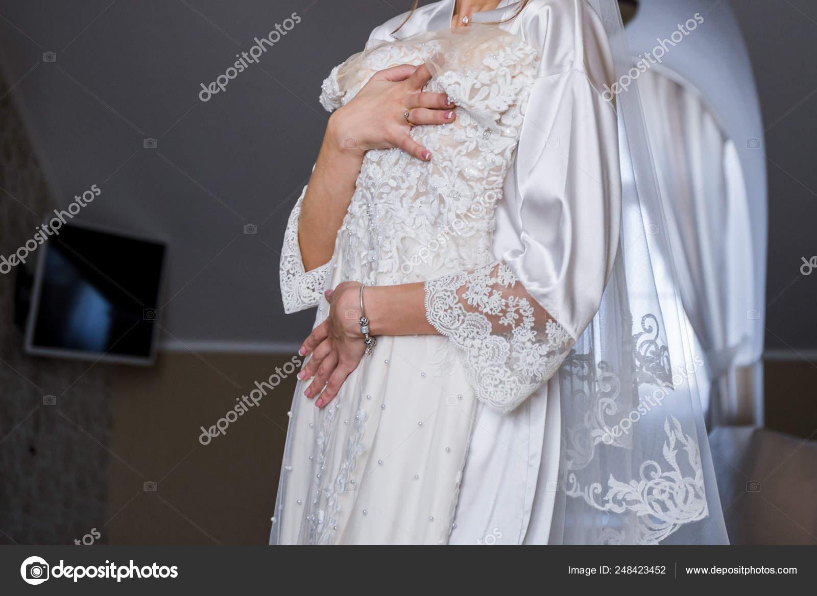 Bride In Bathrobe Holding Wedding Dress In Hands Stock Photo C Dyachenkoproduction Ukr Net 248423452