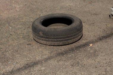 a old car tire on asphalt