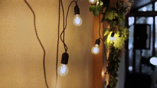 decorative light bulbs on wall in the restaurant