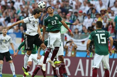 17.06.2018. Moscow, Russian: Hummels and Gallardo in action during the Fifa World Cup Russia 2018, Group F, football match between GERMANY v MEXICO in Luzhniki Stadium  in Moscow.