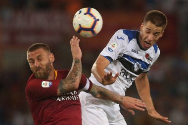 ROME, ITALY - AUGUST 27, 2018: Stadio Olimpico, Rome, Italy. SERIE A: DANIELE DE ROSSI, MARIO PASALIC in action during the ITALIAN SERIE A match between A.S. ROMA V ATALANTA at Stadio Olimpico in Rome