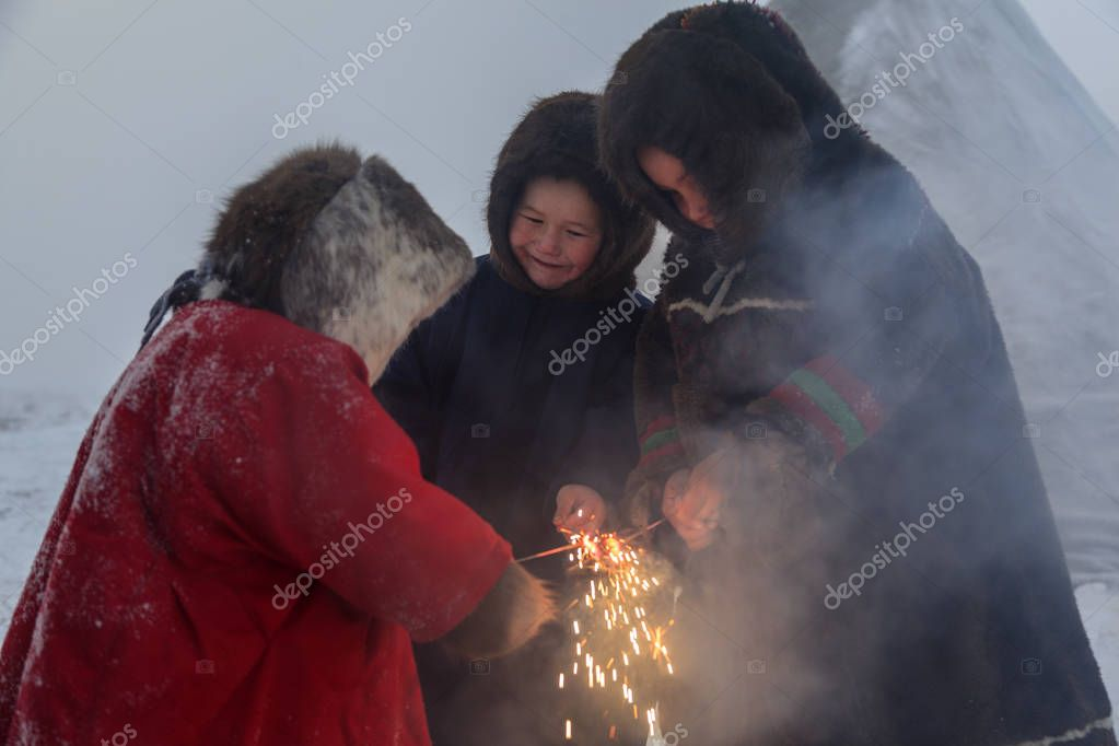 A resident of the tundra, indigenous residents of the Far North, tundra, open area, children  in national clothes