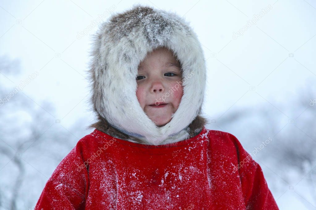 A resident of the tundra, indigenous residents of the Far North, tundra, open area, children ride on sledges, children  in national clothes,Little girl in red clothes