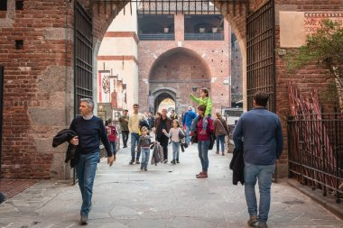 Milan, Italy - November 03, 2017: people come in and out of the Castle of Sforza on a fall day, a fortress built in the fifteenth century by Francesco Sforza, Duke of Milan