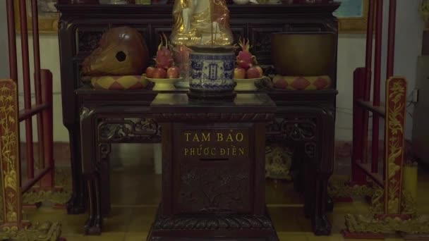 Hanoi, Vietnam - july, 2018: Buddha statue of a Buddhist temple. Gifts and gifts near Buddha statue in pagoda. Asian culture, religion and tradition.