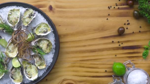 Oysters cooked with cheese and herbs on wooden copy space. Seafood composition. Italian cuisine with seafood. Food background. Healthy nutrition concept.