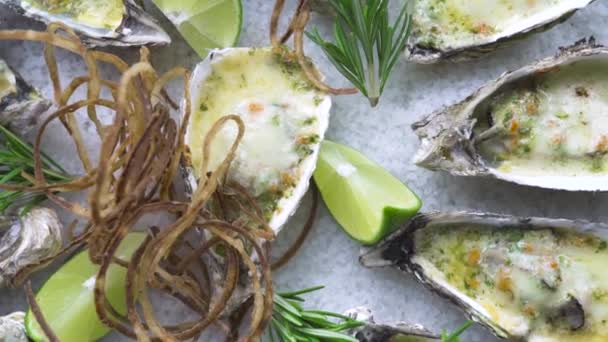 Oysters baked with cheese and herbs on plate on wooden background. Top view seafood background copy space. High cuisine with seafood. Restaurant menu and food composition.