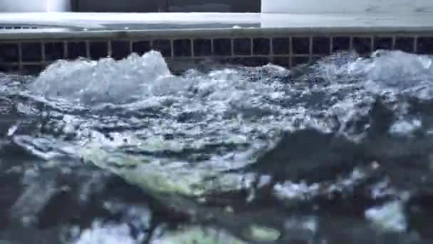 Splashing water in jacuzzi pool on spa center. Boiling water in jacuzzi tub in luxury spa resort hotel. Hydrotherapy and hydromassage concept.