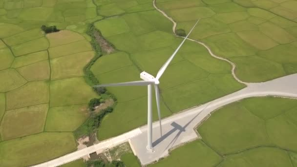 Windmill turbine on green field background. Drone view wind power turbine generation on energy station. Alternative energy sources, ecology and environment conservation. Wind farm aerial landscape.