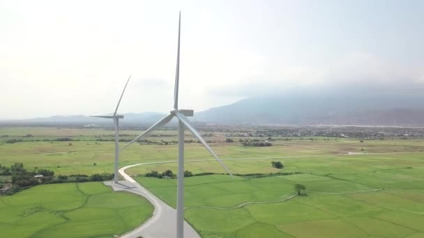 Wind generators on green field aerial landscape. Drone view wind energy station. Alternative natural source and ecology conservation. Clean and renewable energy solution. Eco friendly concept.