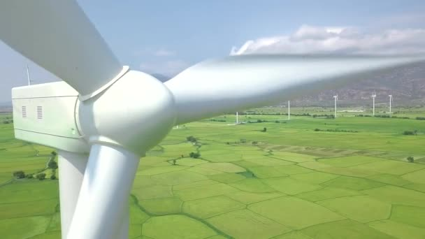 Windmill power turbine generator on energy station close up. Aerial view windmill turbine on eco energy power station, mountain and green field landscape. Alternative sources, ecology, environment.