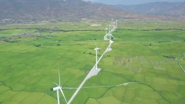 Wind power turbines aerial view. Wind generator for clean renewable energy drone view. Windmill turbine in green field and mountain landscape. Alternative sources renewable energy. Ecology concept.