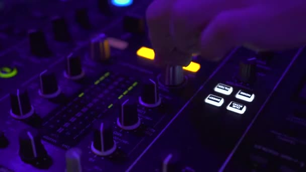 DJ controller for mixing house music and colorful light in disco club. DJ mixer player and sound console for techo dance party. Close up disc jockey console and mixing deck in nightclub.