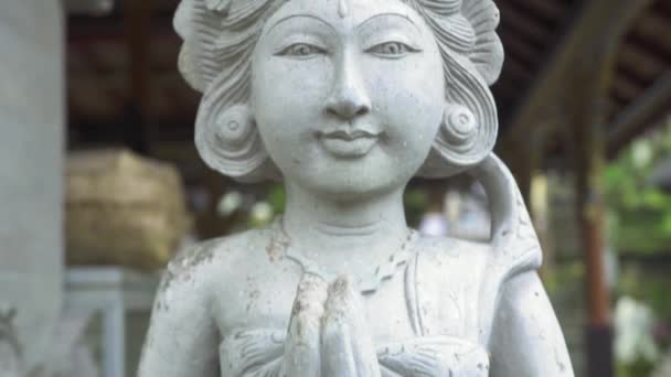 Indonesia god statue in front Bali temple, Indonesia. Traditional indonesian hindu symbol. Ancient sculpture religious idol. Balinese spiritual architecture. Asian culture. Tourism and travel concept.