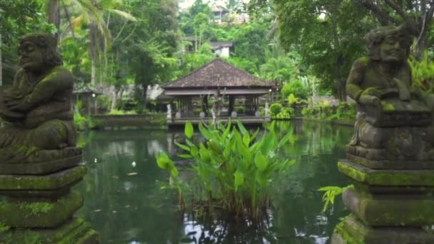 Indonesia god statue in water pond at Bali temple, Indonesia. Traditional indonesian hindu symbol. Ancient sculpture religious idol. Balinese spiritual architecture. Asian culture.