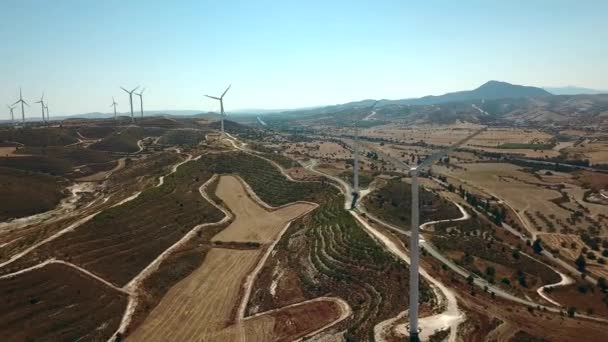 Aerial view of windmills in the mountains, wind power turbines. Wind turbine close-up against a background of mountains. Cyprus