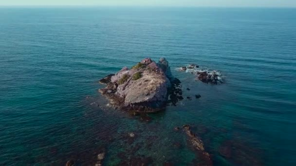 A huge stone in the middle of the sea, an amazing landscape, a flyover from the Copter