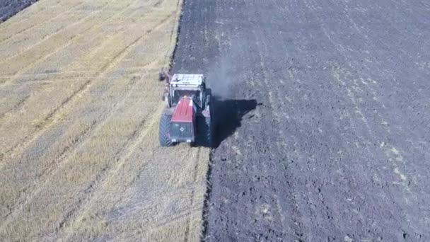 Aerial - Tractor with four furrow plough plowing a field