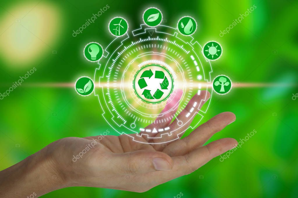 Hand holding with environment icons over the Network connection on nature background, Technology ecology concept