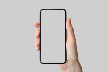 Hand holding bezel-free / frameless modern smartphone in front of neutral background stock vector