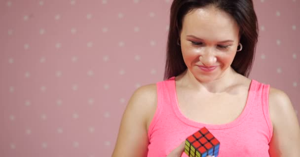Girl collects puzzle Rubiks cube