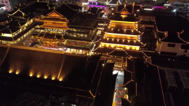 Helicopter Approach Night illumination Yuyuan Garden Shanghai decoration details roofs tile People walk beautiful Pedestrian original Old Ancient street style historical culture Travel sight Aerial 4k