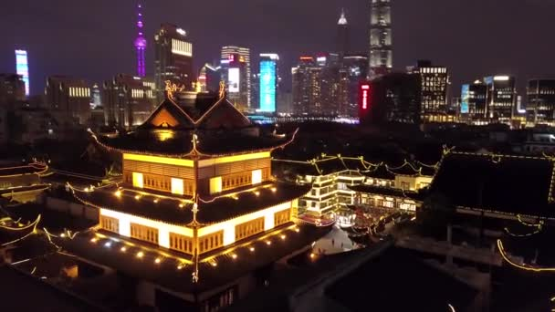 Unique Aerial Around Night illumination Yuyuan Garden Shanghai historical authentic style culture tile roofs Contrast Skyscrapers Pudong Pearl modern colorful glass structure people Travel showplace