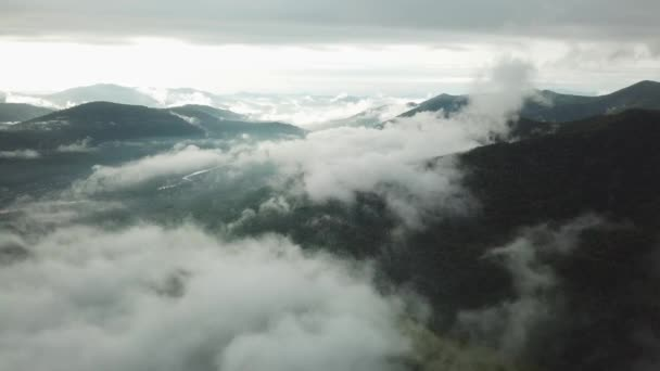 Aerial Fabulous Epic landscape chain of mountains covered white clouds dense fog. Untouched wild open space horizon.