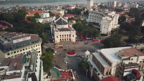 From great height center Hanoi Vietnam capital cityscape. Famous opera house old historic buildings. Road junction traffic. Red river in background. Best travel tourism. Sunny day. Aerial helicopter