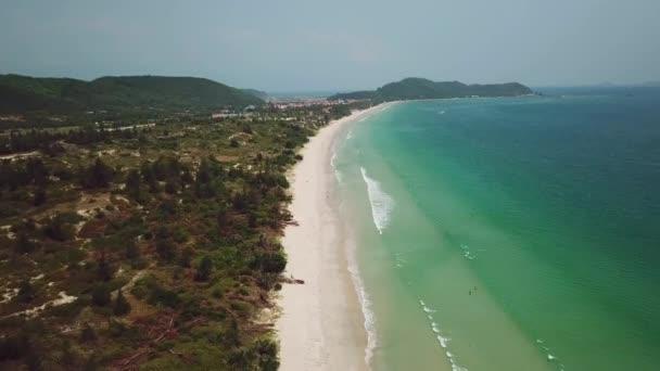 Aerial ascent wild untouched natural Doc Let beach white sand paradise island blue clear water sea ocean waves. Natural landscape seascape horizon. Vietnam relax landmark. Travel tourism. Drone