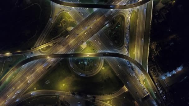 Beautiful night road junction from great height. Modern multi-level complex road active busy traffic jam cars intersection paths pattern. Metropolis logistics journey. Moscow Russia. Aerial