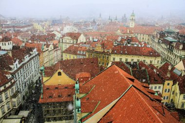 Roofs of Prague, Czech. Winter, Snowfall. Panoramic view of Prague old town.