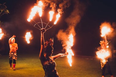 UBUD, INDONESIA - DECEMBER 29, 2017: Balinese traditional dancing with fire show at evening beach party