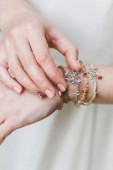 Woman hands with different bracelets and jewellery